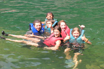Relaxing in the river at coed summer camp